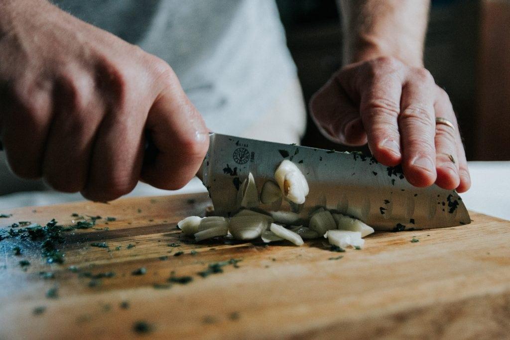 Chopping garlic.