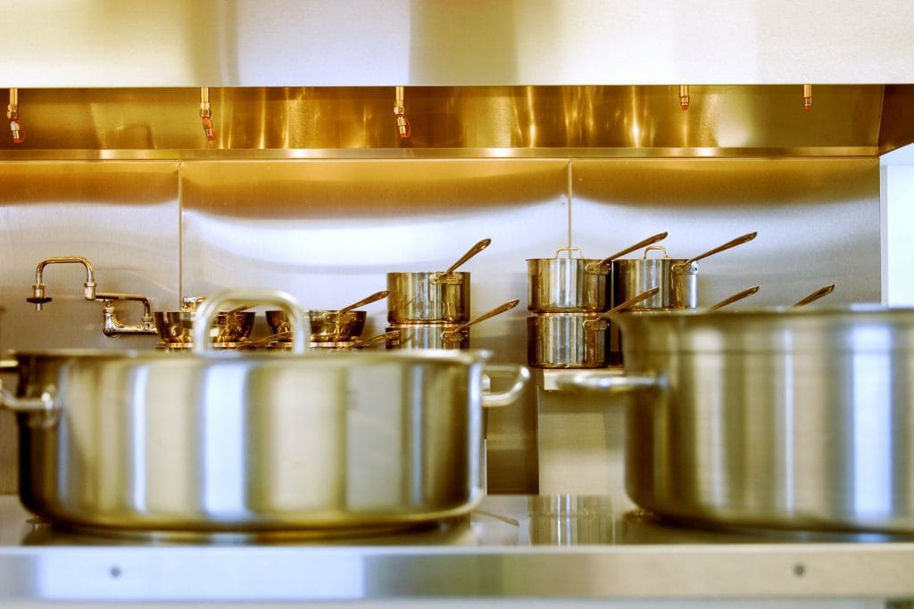 Stainless steel pans in a kitchen.